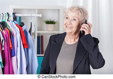 Senior woman arranging meeting on mobile phone