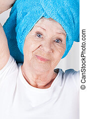 Elderly lady with towel