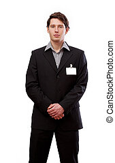 Standing man with card for text - A standing man in a suit...