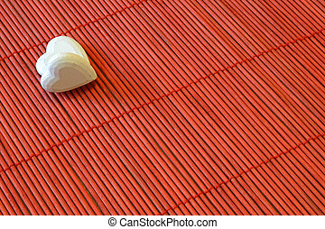 two hearts on red bamboo diagonal - two white hearts on red...