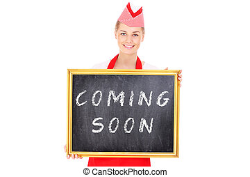 Woman with a coming soon board - A picture of a pretty...