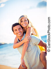 Couple on the beach at sunset - Happy couple on the beach at...