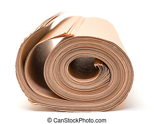 Twisted into roll brown wrapping paper on white background