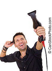 attractive hairdresser using blow dryer and comb -...