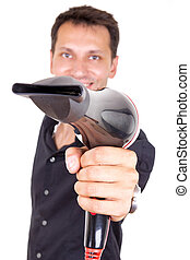 hairdresser holding professional blow dryer, focus on hand...