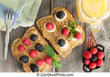 Peanut butter sandwiches with berries and cheese - Overhead...