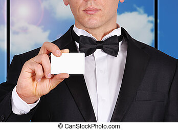 visiting card - businessman in tuxedo holding blank visiting...