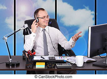 customer service representative sitting in front of desktop