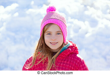 Blond kid girl winter hat in the snow smiling - Blond kid...