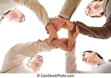Team Work - Small group of business people joining hands,...