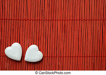 two hearts on red bamboo - two white hearts on red bamboo