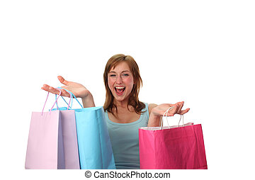 Happy young woman with shopping bags - Young woman with...