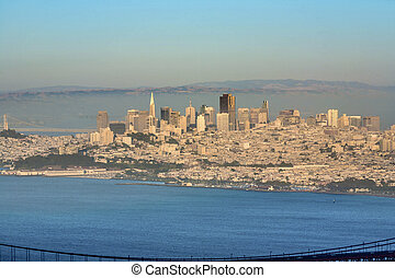 skyline of San Francisco with golden gate bridge in the...