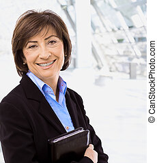 Portrait of senior businesswoman at office lobby