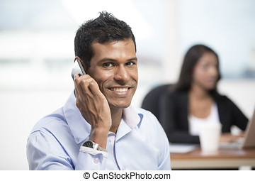 Indian business man using a smartphone - Portrait of an...