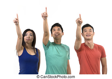 Group of happy Chinese friends pointing upwards.