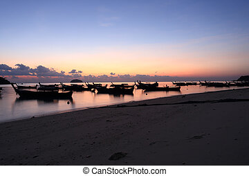 long tail boats at sunset at Koh Lipe in Satun, Thailand