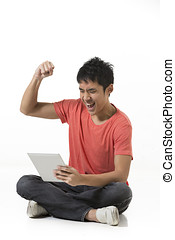 Happy Chinese man using a tablet PC. Isolated on White...