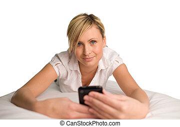 Woman sending a text message - Beautul woman using her phone...