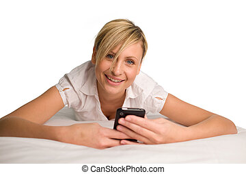 Woman sending a text message - Beautul woman using her phone...