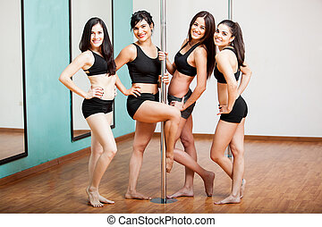 Group of pole dancers having fun - Group of beautiful girls...
