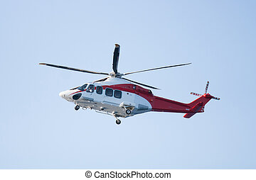 rescue helicopter flying mission in emergency, helicopter...