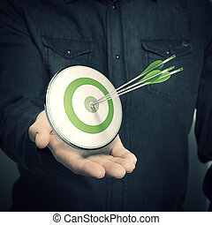 Man Holding Green Target - Marketing Solutions Concept - one...