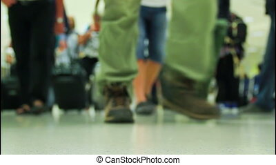 International airport - Crowd of people walking with luggage...