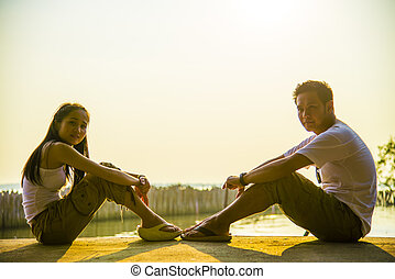 Lovely Couple sit and look together with romance scene3
