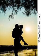 Lovely Couple piggy back ride on sunset in Silhouette  scene3
