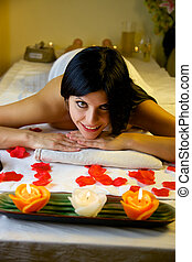 Beautiful woman in spa relaxing waiting for massage