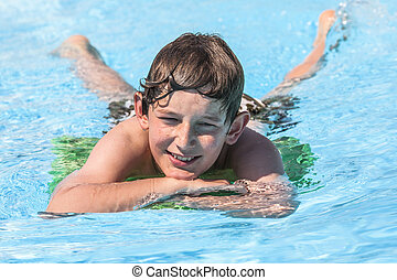 boy swimming in the pool - cute boy swimming in the pool