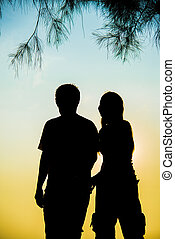 Lovely Couple walk together on sunset in Silhouette scene