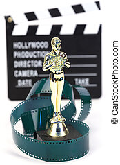 fake Oscar award and movie clapper board , shallow dof