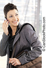 Businesswoman calling on mobile - Portrait of happy young...
