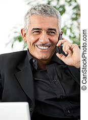 Man calling on phone - Happy mature man calling on mobile...