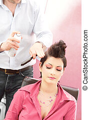Hairstyle salon - Beautiful young woman gets a hairdo in the...
