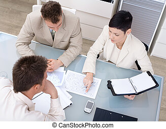 Businessteam working - Businessteam of three working...