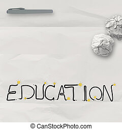 design word EDUCATION on white crumpled paper and texture background as concept