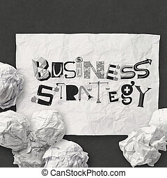 hand drawn on crumpled paper with design word BUSINESS STRATEGY as concept