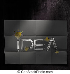 design word IDEA on dark crumpled paper and texture background as concept