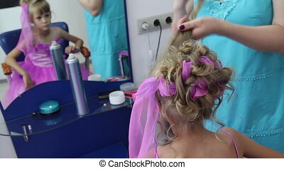 Hairstyle for the Event - Hair stylist creates a girl on the...