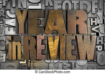 Year in Review - The words YEAR IN REVIEW written in vintage...