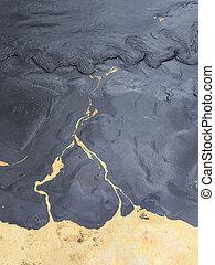 Crude oil on  the beach