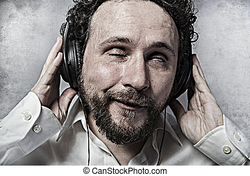 listening and enjoying music with headphones, man in white...