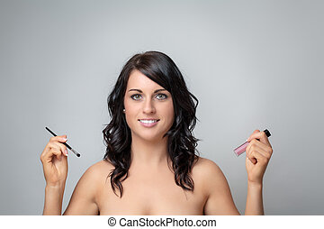 going out - portrait of a beautiful lady putting make up on