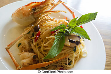 italian spaghetti pasta and fresh spicy shrimps sauce on...