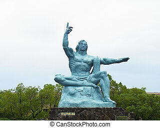Man statue at Nagasaki Peace Part in Nagasaki, Japan. Right...