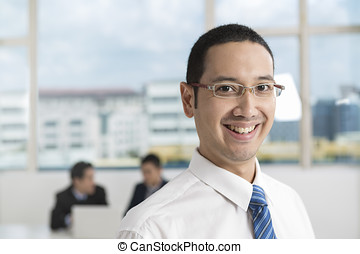 Happy Business man with his multi-ethnic team - A group of...
