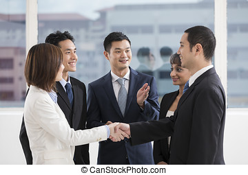 Business man and woman shaking hands - business people...